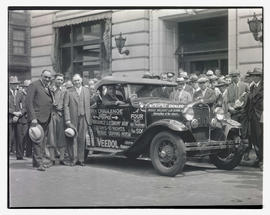 Crowd and Ford car outside Oregon Journal building
