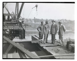 Four men on Ross Island Bridge during construction