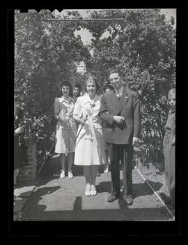 1942 Portland Rose Festival Queen Shirley Fowler and unidentified man at Lambert Gardens?