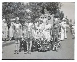 Costumed children with parade float
