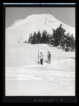 Skiers standing on Mt. Hood slope