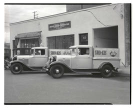 Delivery trucks parked outside Sno-Kis Fruit Corporation, Water and Yamhill, Portland