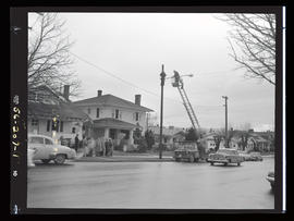 Utility workers installing 2000th Portland streetlight, at Northeast 43rd Avenue and Northeast Gl...
