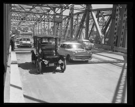 Antique automobile crossing newly opened Interstate Bridge span