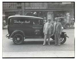 Two unidentified men with Buckeye Malt car