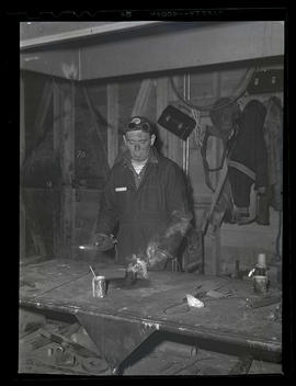 Welder with blowtorch, Albina Engine & Machine Works, Portland