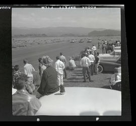 Spectators watching Volkswagen Beetles race in Tillamook, June 1955