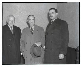 Julius L. Meier with two unidentified men