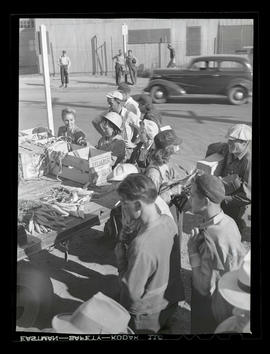 Workers buying produce during market at Albina Engine & Machine Works, Portland