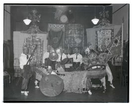 Suey Sing members with instruments and lion-dance costume