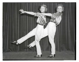 Teenage tap dancers in costume