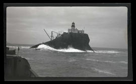 Tillamook Rock Lighthouse and approaching rowboat