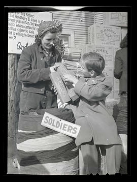 Worker handing cigarettes to Sid Woodbury IV during drive at Albina Engine & Machine Works