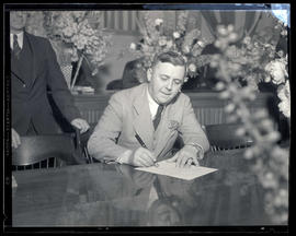 Portland Mayor Joseph K. Carson signing document at his inauguration