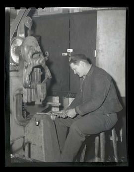 Worker using machinery, Albina Engine & Machine Works, Portland