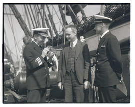 Officers of USS Constitution presenting miniature cannon to Oregon Journal writer Wallace S. Wharton