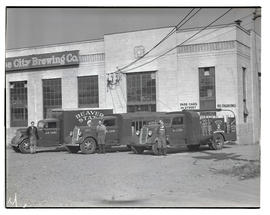 Three men with delivery trucks outside Rose City Brewing Co., NE Madrona Street, Portland