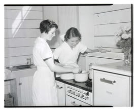 Young women cooking