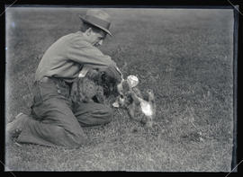 William Finley Feeding Cougar Cubs