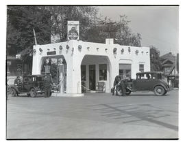 Cars getting fuel at Texas Company service station