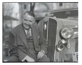 Barney Oldfield with car