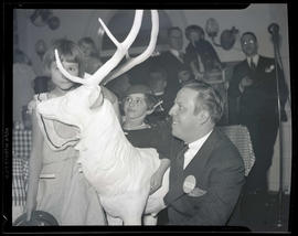 Dan E. Gould and two unidentified children with stag statue at Portland Breakfast Club party