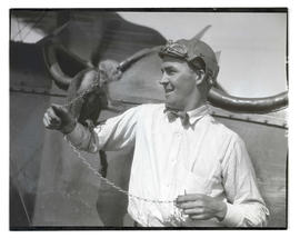 Lieutenant William B. Clark holding monkey at Pearson Field, Vancouver, Wash.