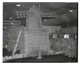 Log windmill exhibit, probably at Pacific International Livestock Exposition