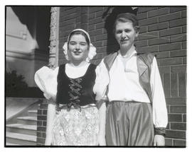 Two unidentified girls in costume, posing outside YWCA building in Portland