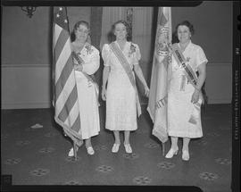 Women with sashes and flag at Spanish War veterans gathering