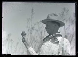 Herbert Brown holding an elf owl