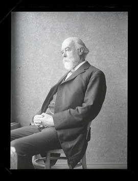 Sir Oliver Lodge, seated in chair