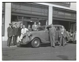 Unidentified men with car