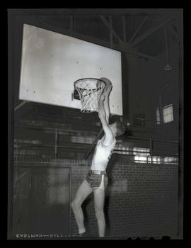 Lloyd Jackson?, basketball player for Albina Hellships, shooting layup