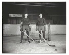 Portland Buckaroos players on ice rink