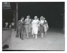 Aimee Semple McPherson? and three unidentified people at Union Station, Portland