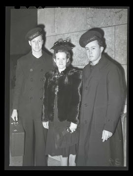 Melva Lillian Cole with Navy servicemen K. A. Johnson and W. N. Edwards after her arrival in Port...