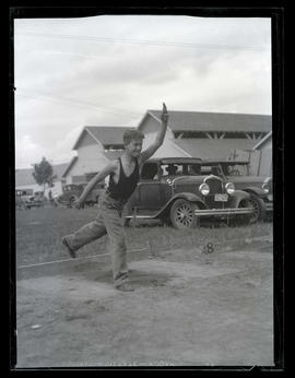 Boy playing horseshoes?