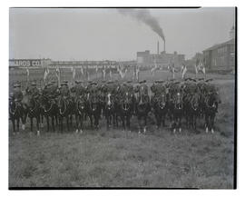 Royal Canadian Mounted Police unit on horseback, probably at Pacific International Livestock Expo...