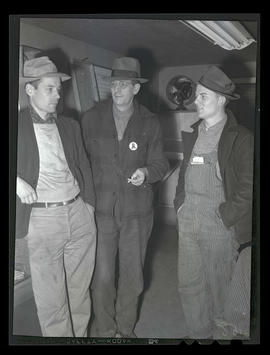 Three workers in office, Albina Engine & Machine Works, Portland