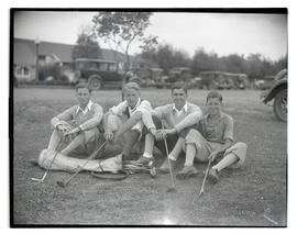 Four teenage golfers