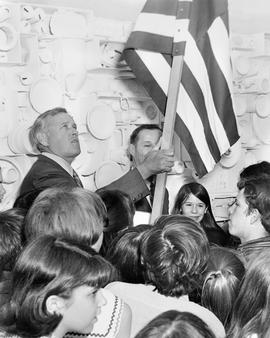 Governor Tom McCall holding an ecology flag at a 1970 Earth Day Celebration