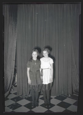 Two girls, possibly dancers, in costume