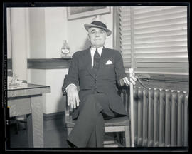 Ray Baker, seated in chair