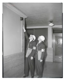 Air raid wardens looking at speaker during drill at Public Service Building, Portland