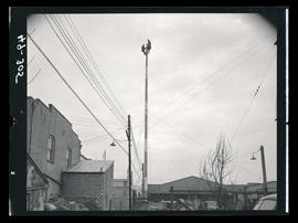 Two men at top of utility pole