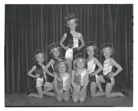 Seven young tap dancers in costume