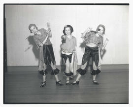 Three young tap dancers in pirate costumes