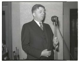 Charles F. Walker? standing at microphone