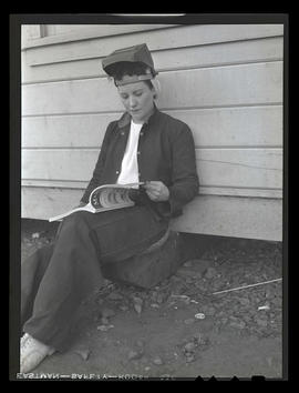 Welder Jeannine Christensen reading book, Albina Engine & Machine Works, Portland